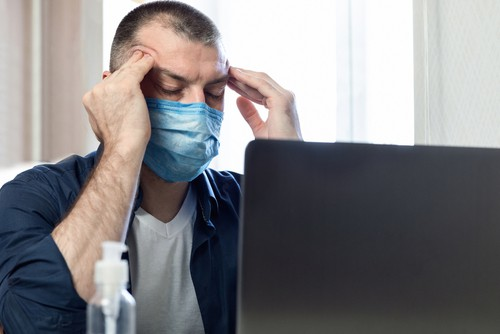 stressed man in a mask